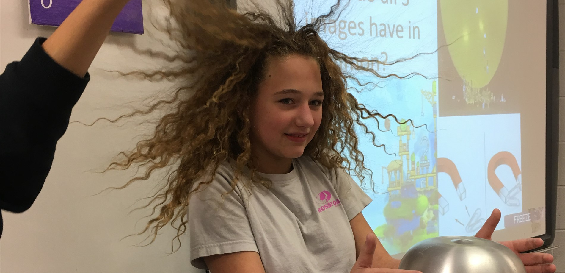 Students study the effects of static electricity in 7th grade science class.