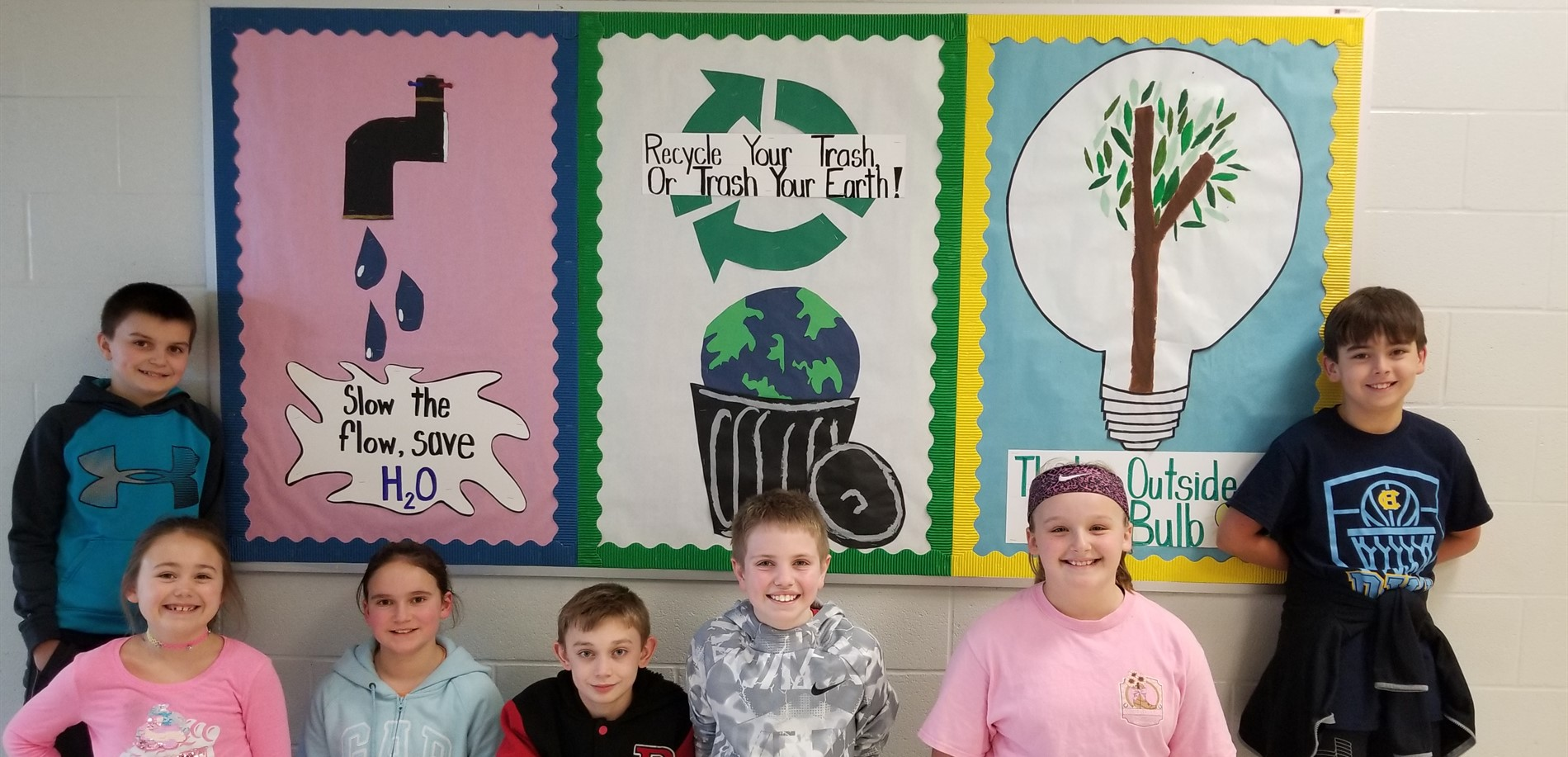 The Green Team reminds us about recycling and saving energy using their bulletin board.
