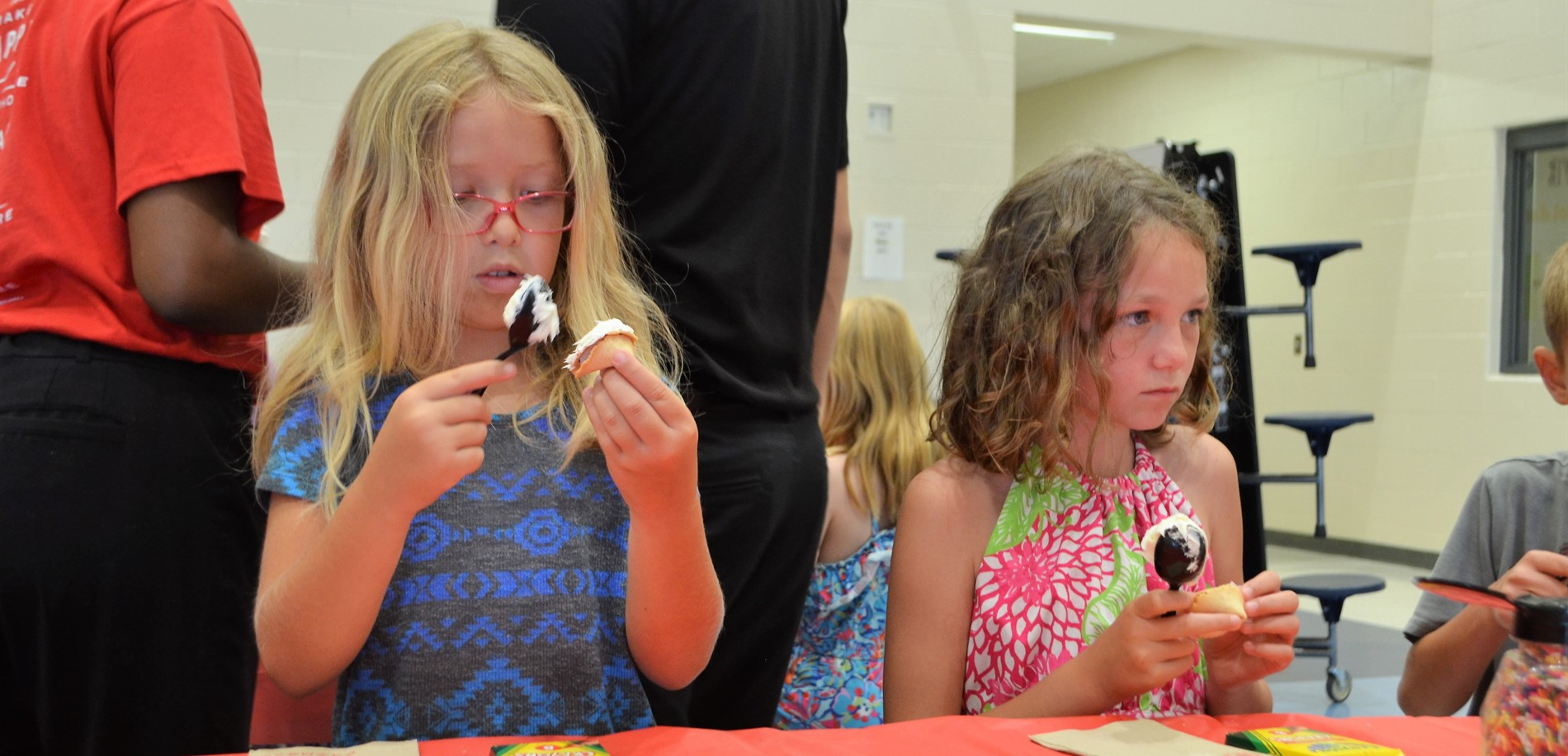 Panda Express stopped by summer reading camp to help students decorate fortune cookies.