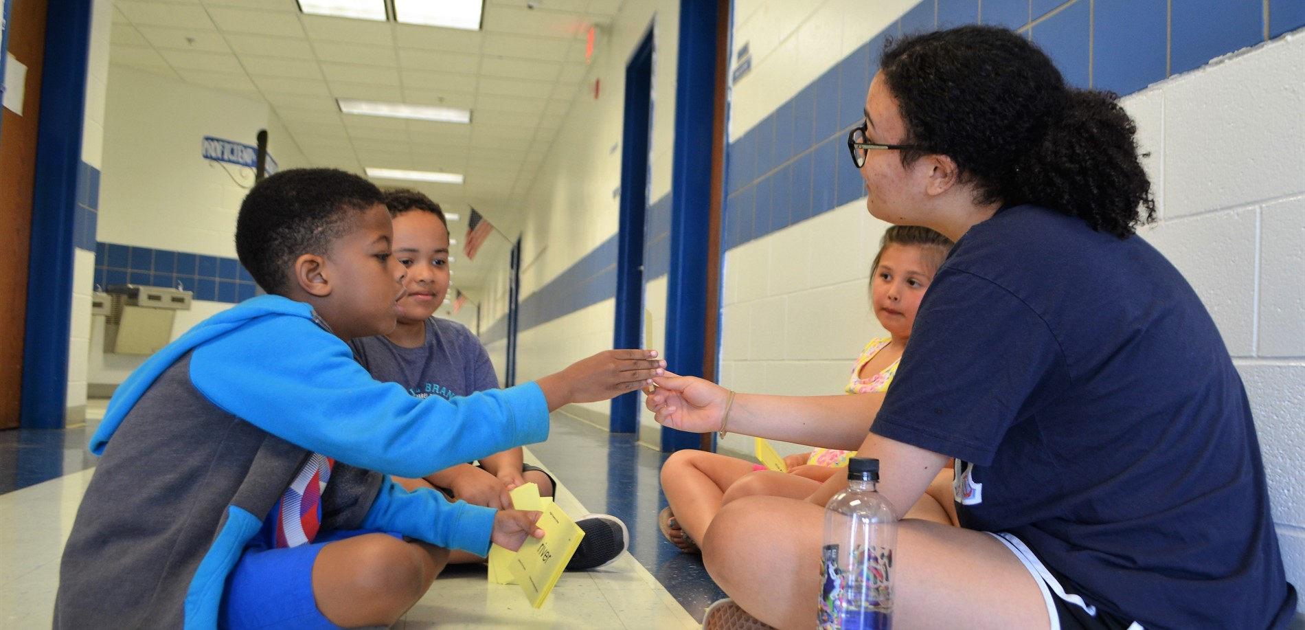 A North Hardin High School student works with elementary students during summer reading camp at Woodland Elementary.