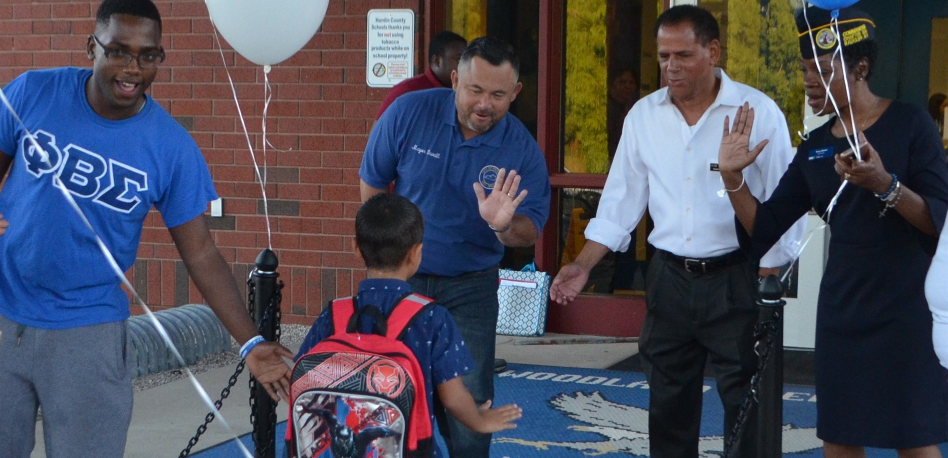 Radcliff Mayor JJ Duvall and Councilman Kim Thompson greet students at Woodland Elementary.