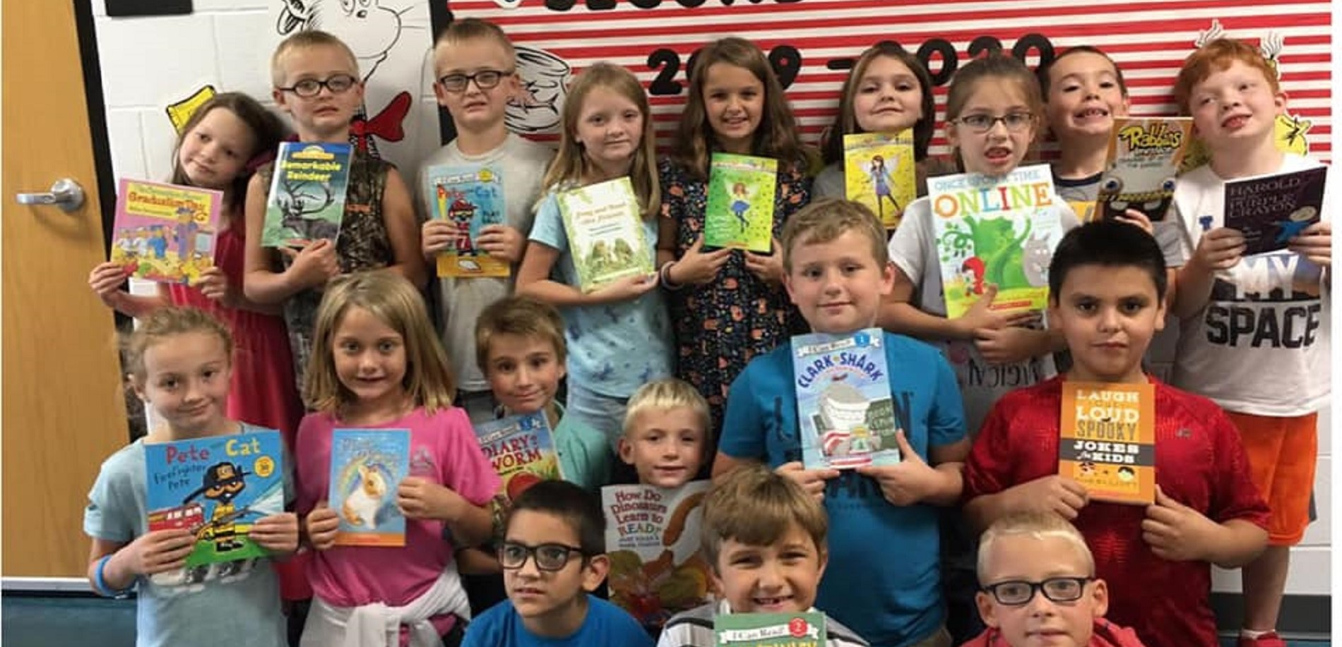 These CVES students will receive one book per month after receiving a generous donation from Leitchfield Veterinary Clinic.