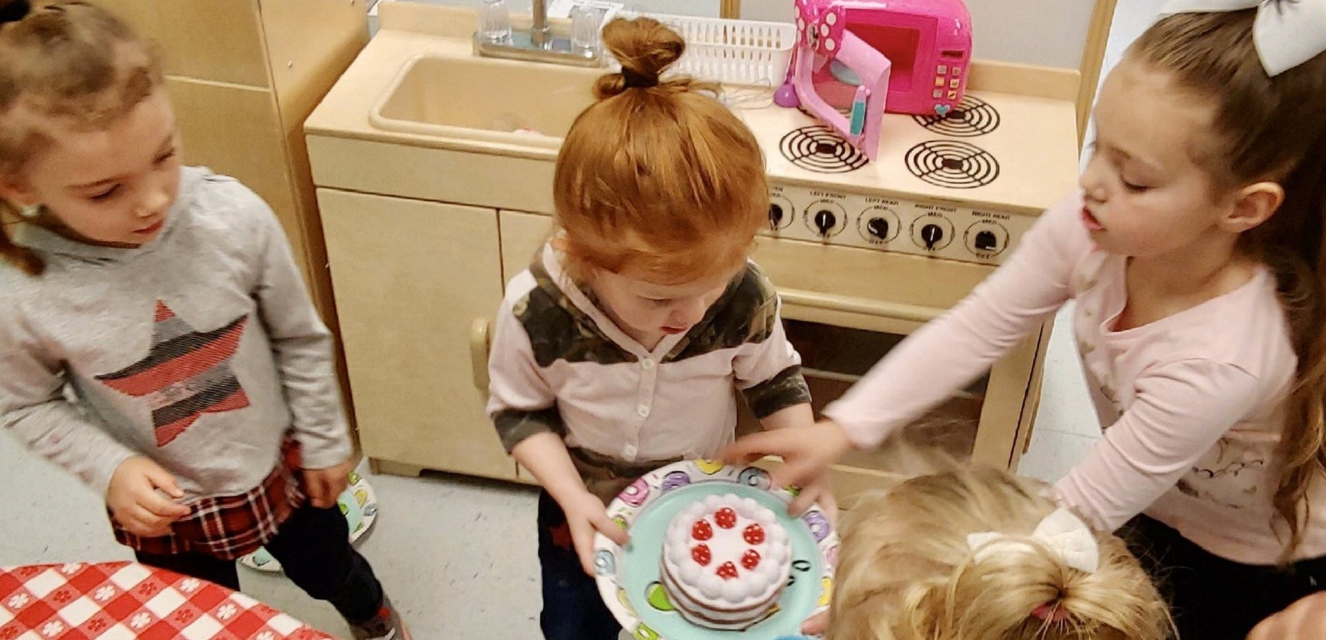 Preschool students at Lakewood Elementary manage a bakeshop in their dramatic play center!.
