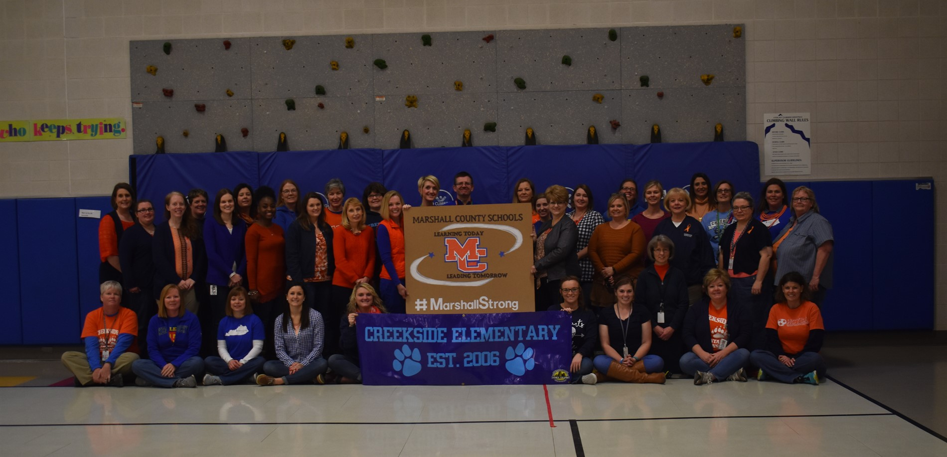 Creekside Elementary Faculty and Staff wore orange and blue to support Marshall County.