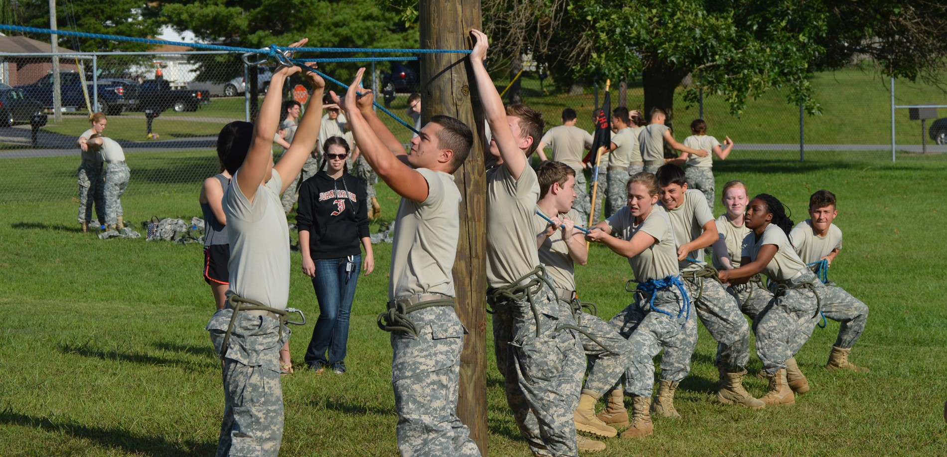 JROTC Raider Team constructing one-rope bridge