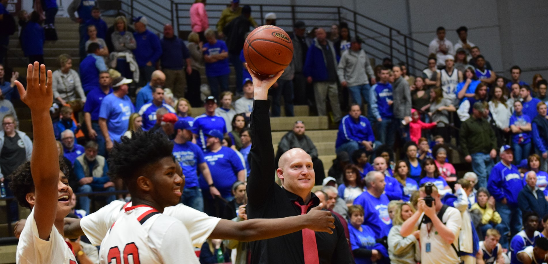 Coach Jared McCurry celebrates the JHHS boys basketball 5th Region Championship win.