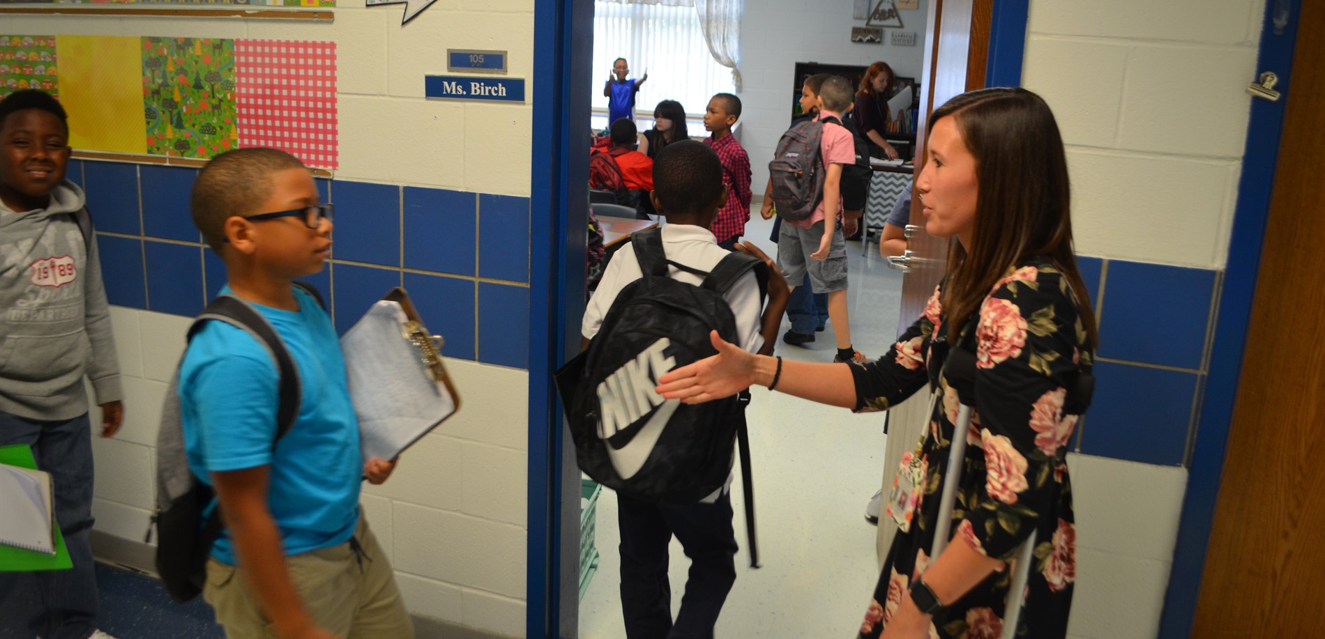 Ms. Birch welcome students to her class with a handshake at Woodland Elementary School