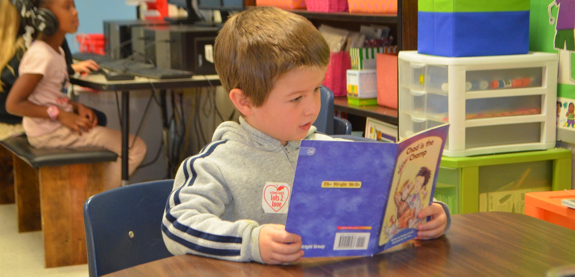 This New Highland Elementary School student is having a great time reading.