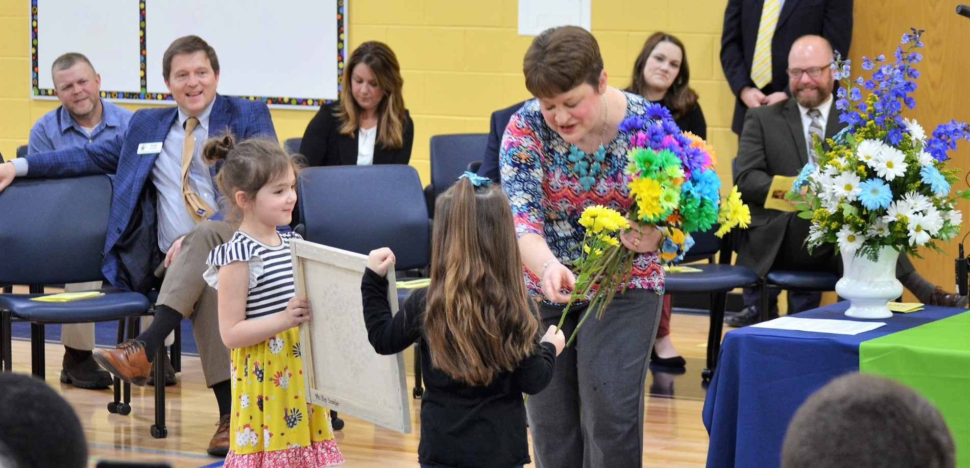 Cecilia Valley Elementary School teacher Kim Crowder receives flowers and gifts from her students during the HCS WHAS 11 ExCEL Award Ceremony.