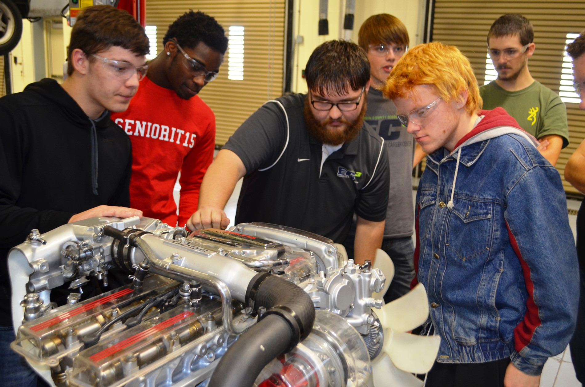 Early College & Career Center automotive students study an  engine donated by the Swope Family of Dealerships.